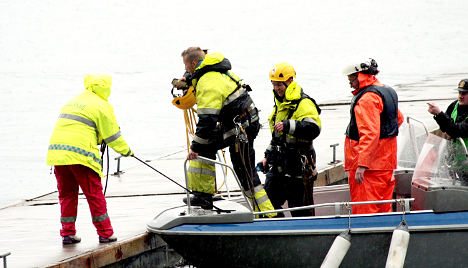 Workers safe after high-wire fjord rescue
