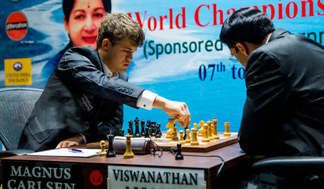 Carlsen ahead in world chess duel with Anand