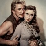 """<strong>Husband.</strong> From the Old Norse """"husbondi"""", meaning """"master of the house"""". Replaced the Old English """"wer"""", the counterpart of the surviving term """"wife"""", presumably reflecting the way women in England found their slaughtered Anglo-Saxon """"wers"""" replaced by new Norse """"husbondi"""". Photo: Kirk Douglas plays Einar, heir to the Kingdom of Northumbria, in the classic 1958 film The Vikings, alongside Janet Leigh."""