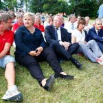 Sitting in solidarity: Prime Minister Erna Solberg is joined by fellow mourners as they remember the dead.Photo: Heiko Junge / NTB scanpix
