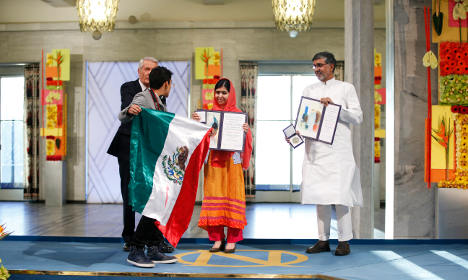 Man with Mexican flag disrupts Nobel ceremony
