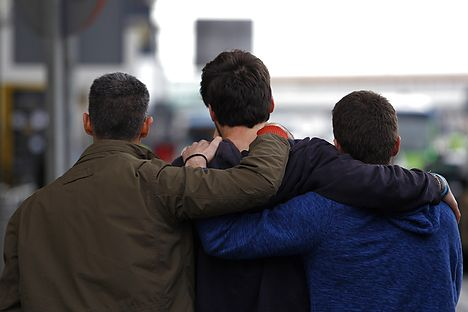 Family members of an aircrash victim clasp one another at Barcelona's El Prat airport on Tuesday. AFP PHOTO / QUIQUE GARCIA