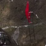 Norway man in 'human flag' stunt over waterfall
