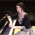 Dead pianist's husband did time for beating her