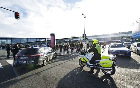 Police stand in front of Terminal 3 at Copenhagen Airport on Thursday.