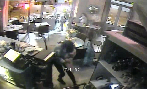 Footage shows woman's lucky escape from gunman
