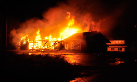 Two charged for Norway asylum centre fire