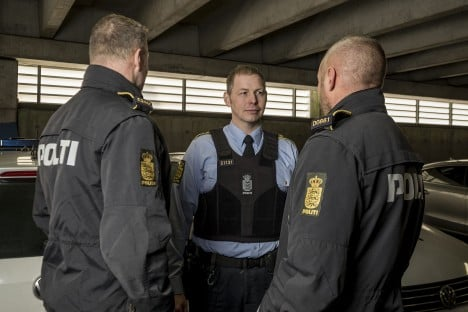 Officers display the new ID system. Photo: Danish National Police
