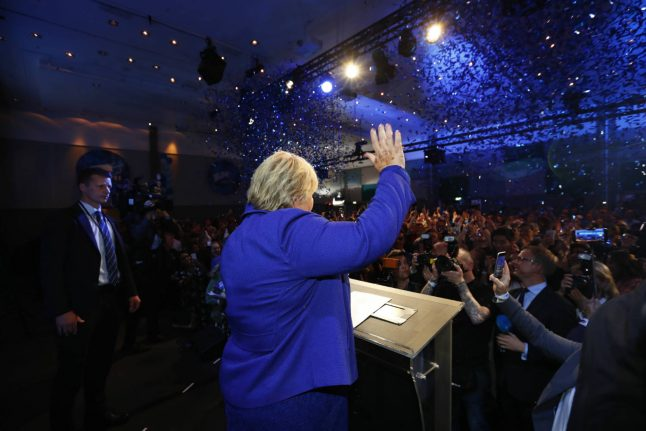 Norway's PM Solberg claims victory in close election