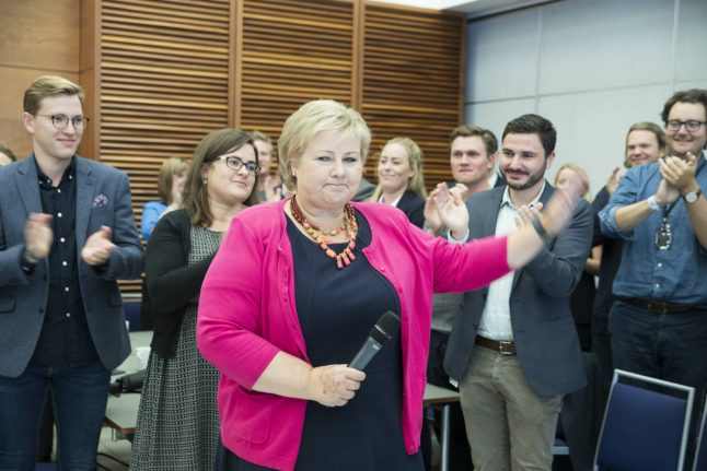 Bittersweet election victory for Norway PM Solberg