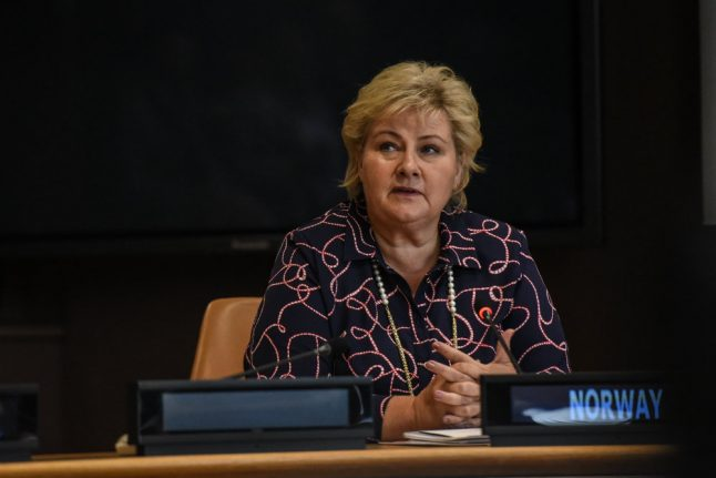 Why has Norway's PM Erna Solberg been accused of 'swallowing camels against the direction of their hair'?