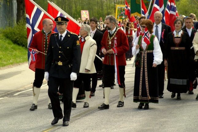A group of Norwegians partaking in a May 17th parade in their bunads.