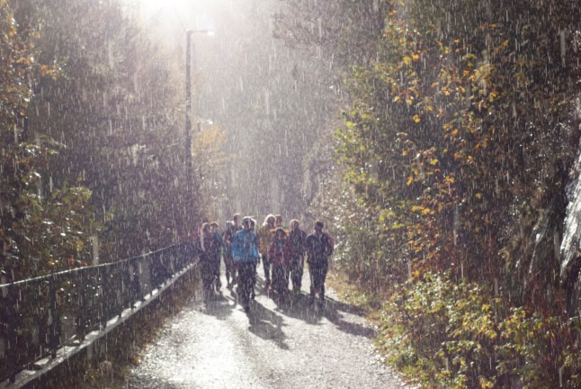 A group of children getting caught in the rain in Ulriken, Bergen, Norway. Rain battered parts of Norway on Sunday.
