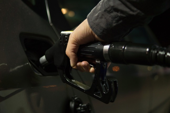 The government have proposed raising petrol tax. Picutred is somebody filling up their car